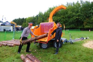 Jensen Business Manager Bill Johnston and Sales Representative Nathan Jacobs with Jensen woodchipper at APF show