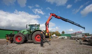 Owner Mark Davis with new Palfinger crane on Tractor