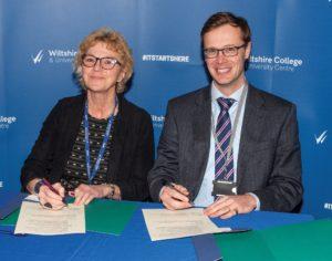 Amanda Burnside & Alex Scott signing joint agreement